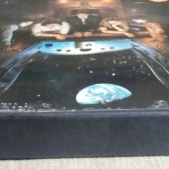 Edge of front cover of promo box