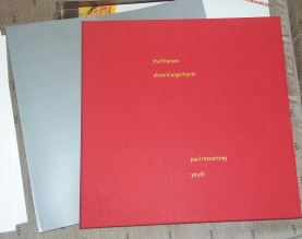 Red booklet with 4 discs